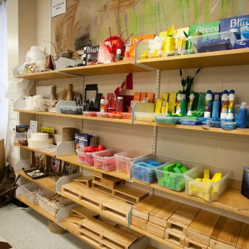 Image of art materials on shelves